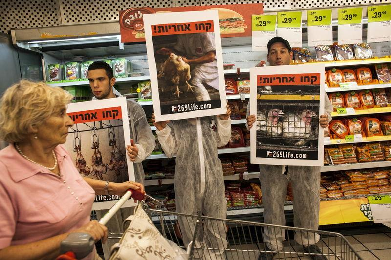 File photo of activists standing in front of meat products at a supermarket in Tel Aviv
