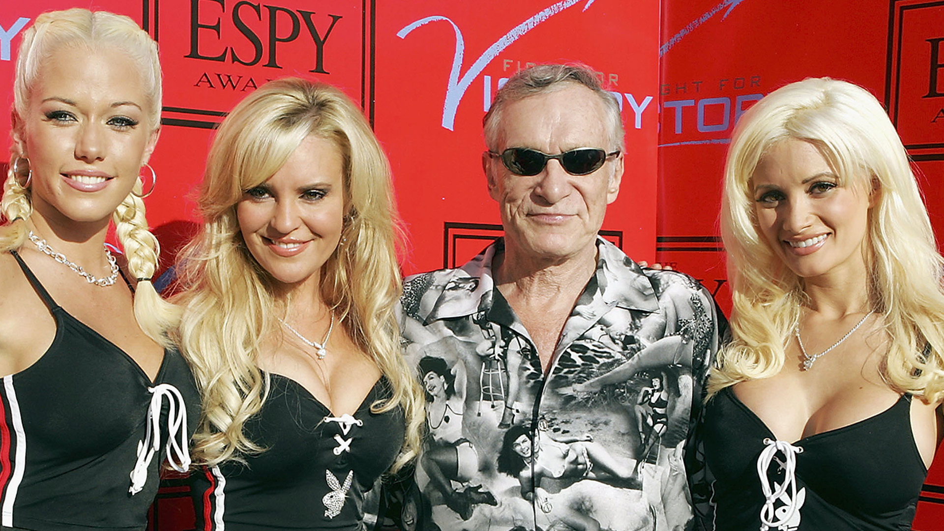 """BEVERLY HILLS, CA - JULY 12: Playboy's Hugh Hefner and his Playmates, Kendra Wilkinson (L), Bridget Marquardt and Holly Madison (R) arrive at """"Fight for Victory"""", the 13th Annual Espy Pre-Party hosted by Andy Roddick at the Playboy Mansion on July 12, 2005 in Beverly Hills, California. (Photo by Kevin Winter/Getty Images) *** Local Caption *** Hugh Hefner;Kendra Wilkinson;Holly Madison;Bridget Marquardt"""